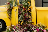 02 This gorgeous yellow truck was filled with bright blooms to make a statement decoration for this modern wedding shoot