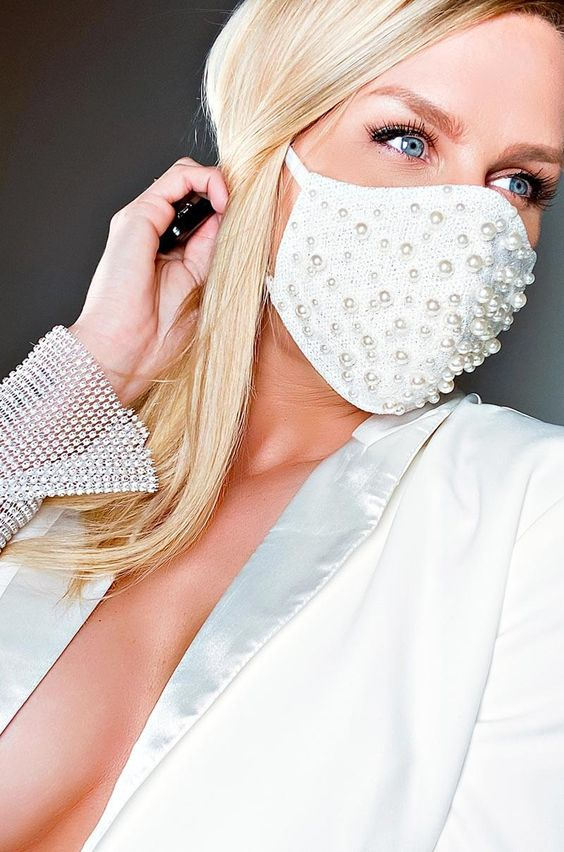 a beautiful white face mask with lots of pearls of various sizes is a lovely and stylish idea