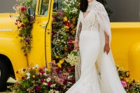03 One bride was wearing a romantic mermaid wedding dress with a lace bodice and a plain skirt, a train and a capelet