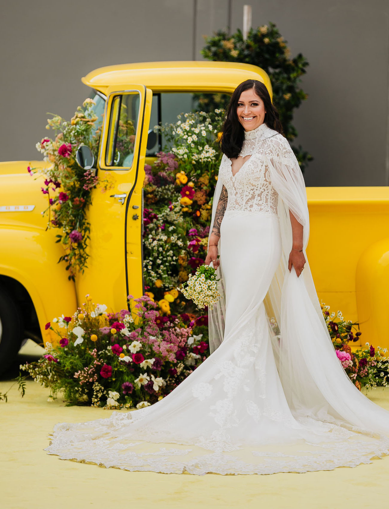 One bride was wearing a romantic mermaid wedding dress with a lace bodice and a plain skirt, a train and a capelet