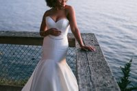 03 The bride was wearing a strapless mermaid wedding dress with an embellished sash and rocking her Afro hair