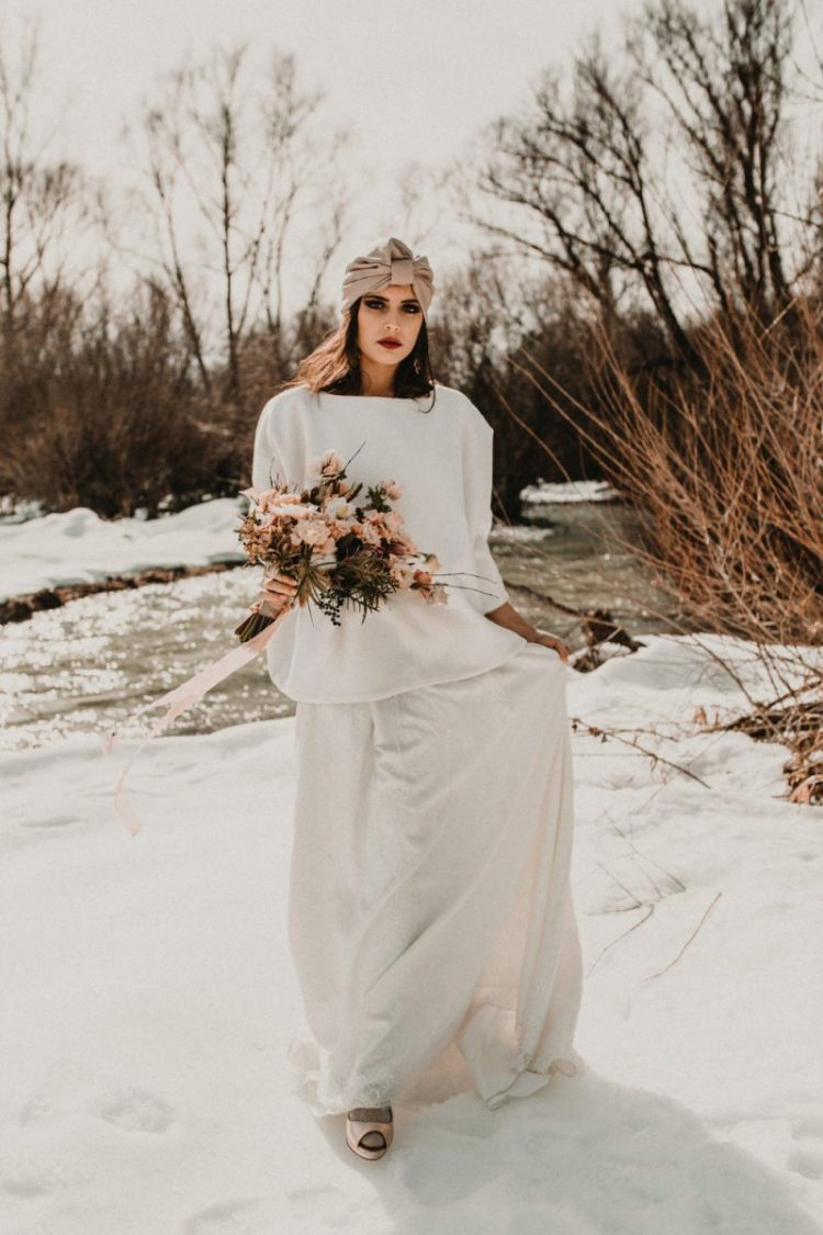 The bride was wearing a white oversized sweatshirt and a lace maxi skirt with a train, silver shoes and a turban