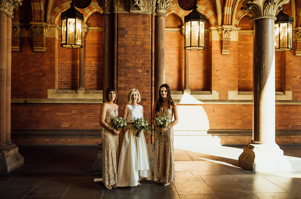 The bridesmaids were wearing strapless fully embellished maxi dresses with pleating