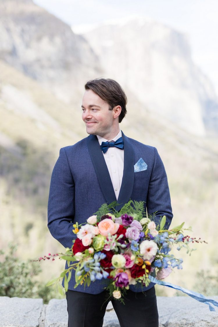 The groom was wearing a grey printed tux with black lapels, a navy bow tie and black pants