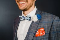 03 The groom was wearing a plaid grey three-piece suit, a botanical print bow tie and a colorful boutonniere