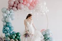 03 The wedding arch was done with ombre balloons – form white to blue and green, pastel blooms and celetial pieces hanging