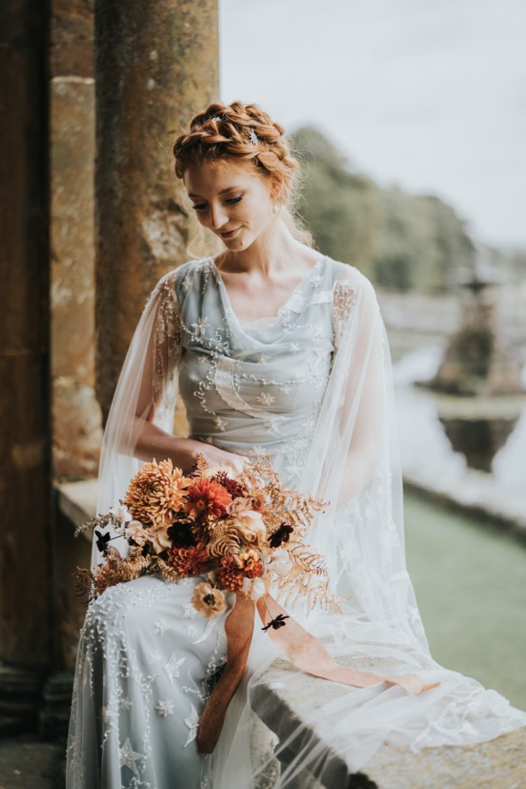 The wedding bouquet was very fall-like, with rust, orange, purple blooms and dried leaves