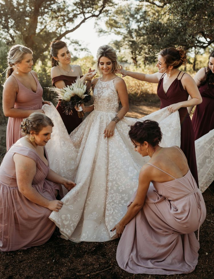 The wedding dress was a super romantic floral ballgown with an illusion neckline, the bridesmaids were wearing dusty pink and burgundy