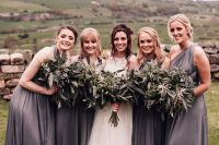 04 The bridesmaids were wearing mismatching grey maxi dresses and carrying the same greenery bouquets