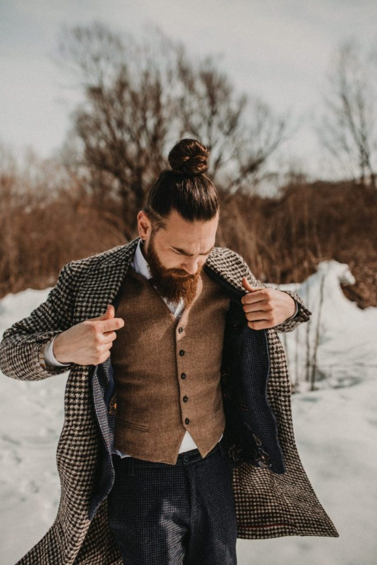The groom was rocking a woolen waistcoat, plaid grey pants, a gingham coat and a bow tie plus a top knot