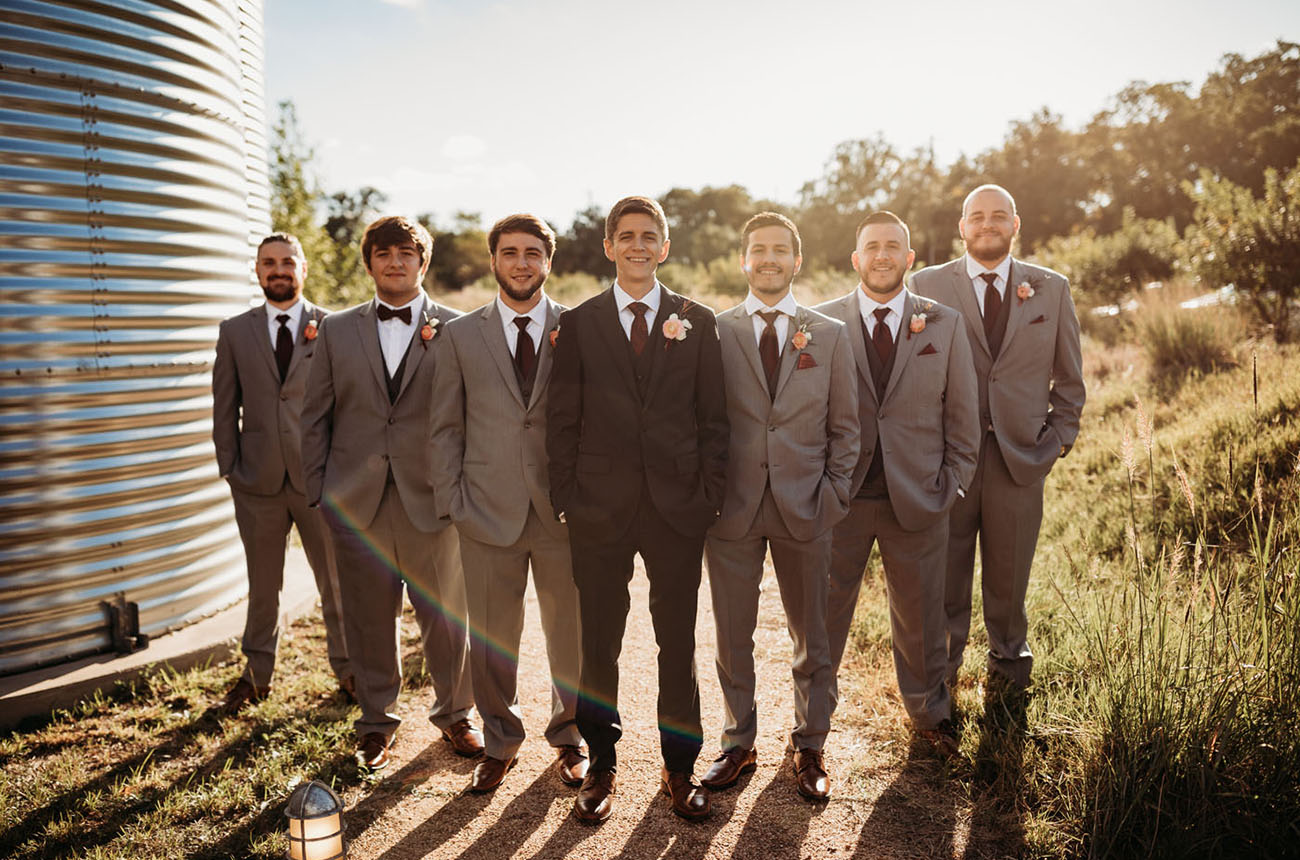The groom was wearing a dark grey three piece suit and the groomsmen were rocking dark waistcoats and lighter suits