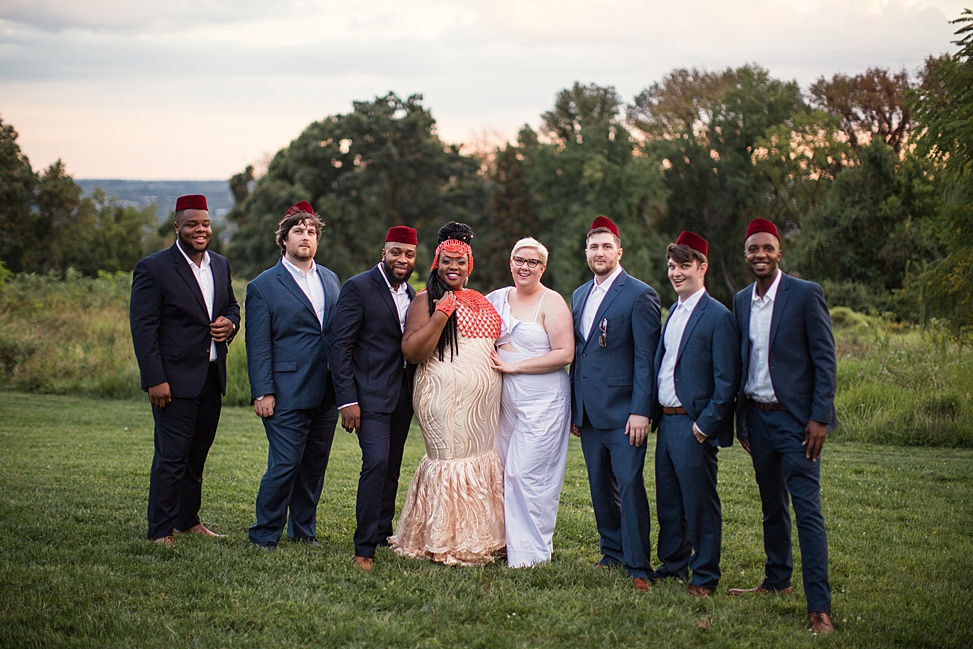 The groomsmen were dressed into navy suits and white shirts plus burgundy hats that are also traditional