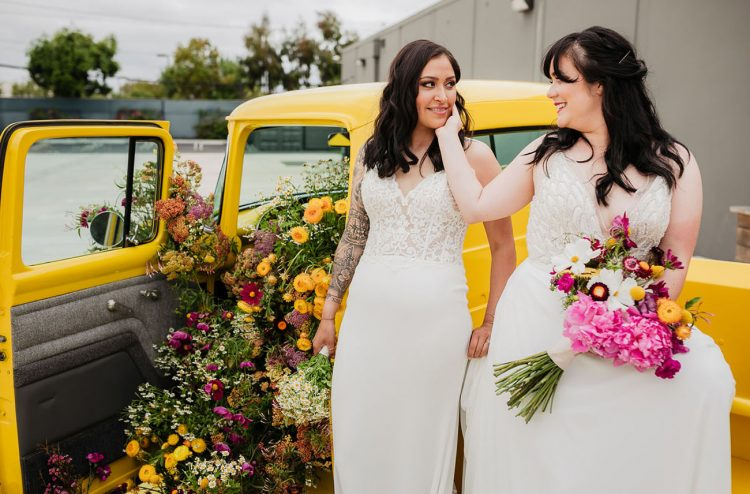 The second bride was wearing an A-line-wedding dress with a fully embellished bodice and a plain skirt
