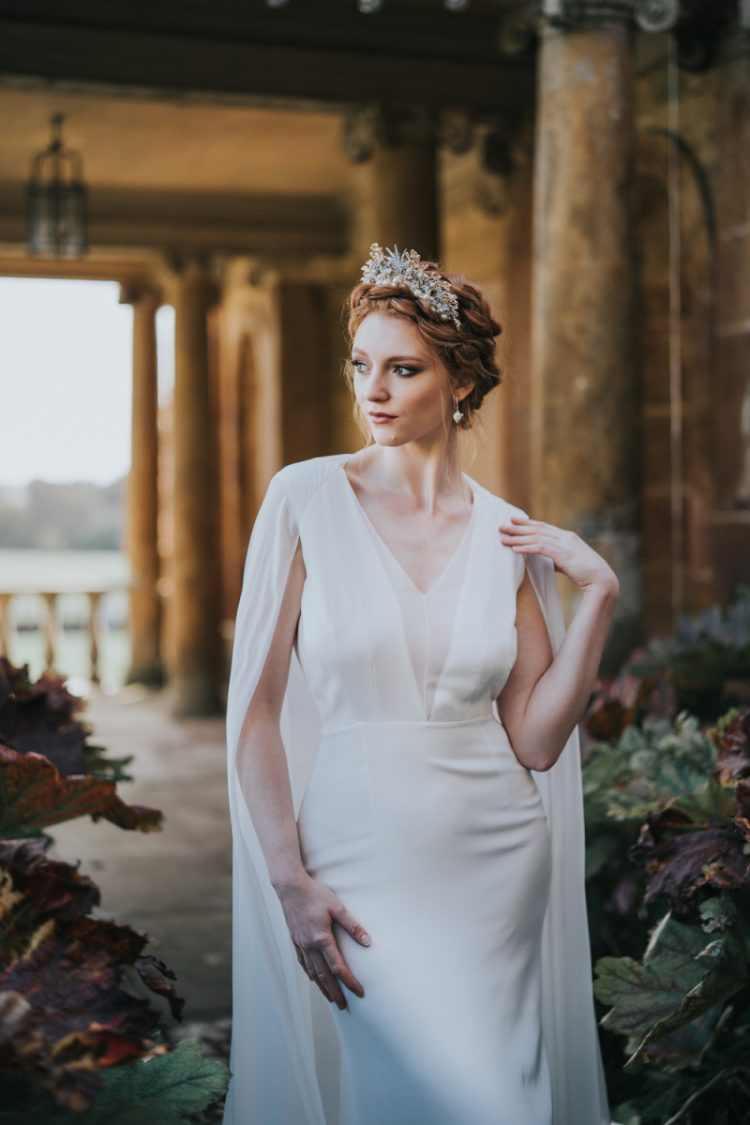 The second wedding dress was a white modern one, with a V-neckline and a capelet
