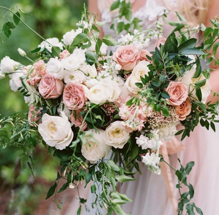 The wedding bouquet was done with white and pink blooms and lots of greenery and looked very lush