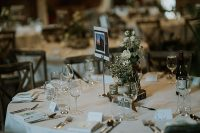 04 The wedding tablescapes were very simple and elegant, with neutral floral centerpieces, burlap, wood slices