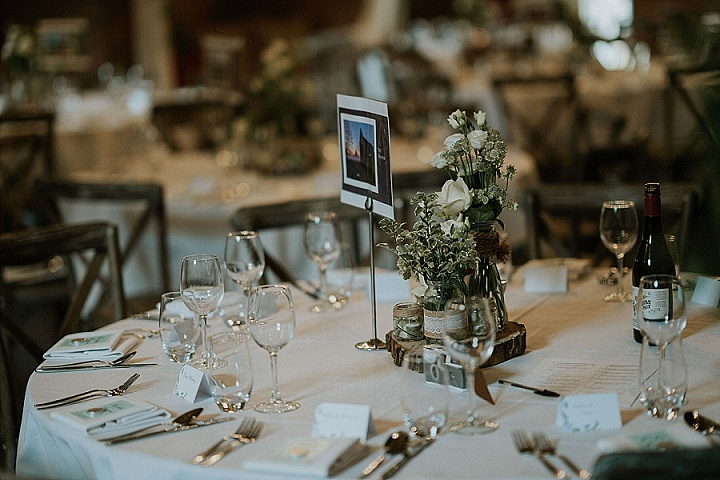 The wedding tablescapes were very simple and elegant, with neutral floral centerpieces, burlap, wood slices