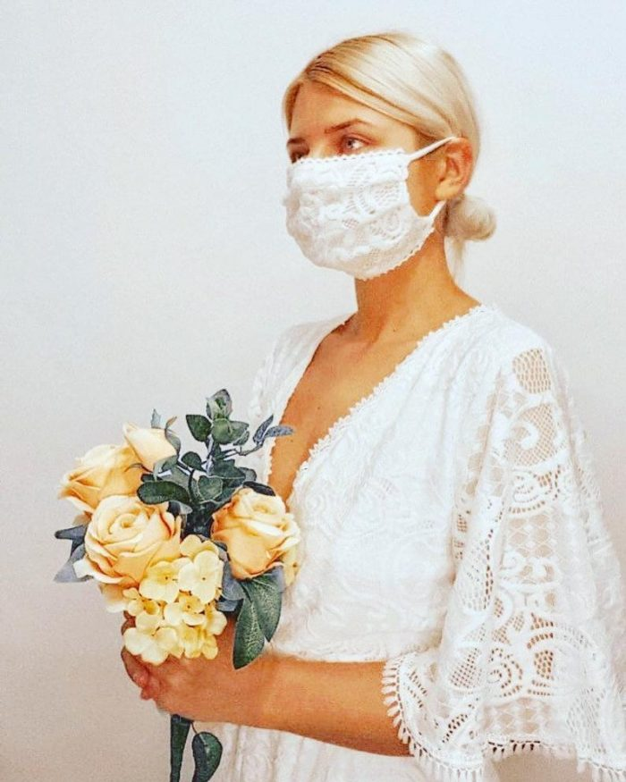 a custom lace face mask that match the wedding dress is a lovely idea to go for