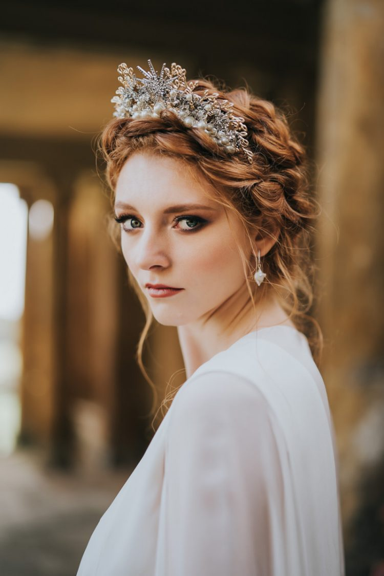 The braided updo was accented with a fantastic rhinestone and pearl crown and the bride was wearing baroque pearl earrings