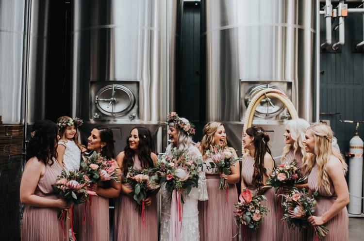 The bridesmaids were rocking blush pleated halter neckline dresses