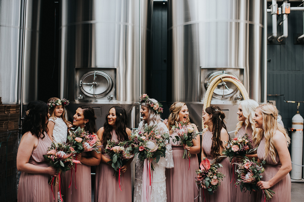 The bridesmaids were rocking blush pleated halter neckline dresses