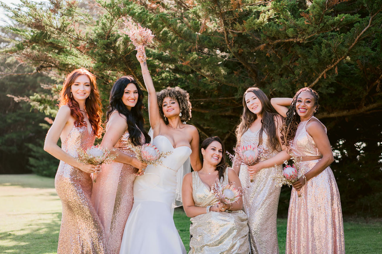 The bridesmaids were rocking gorgeous mismatching gold and rose gold sequin gowns