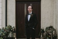 05 The groom was wearing a black tux with a velvet bow tie and a cool boutonniere
