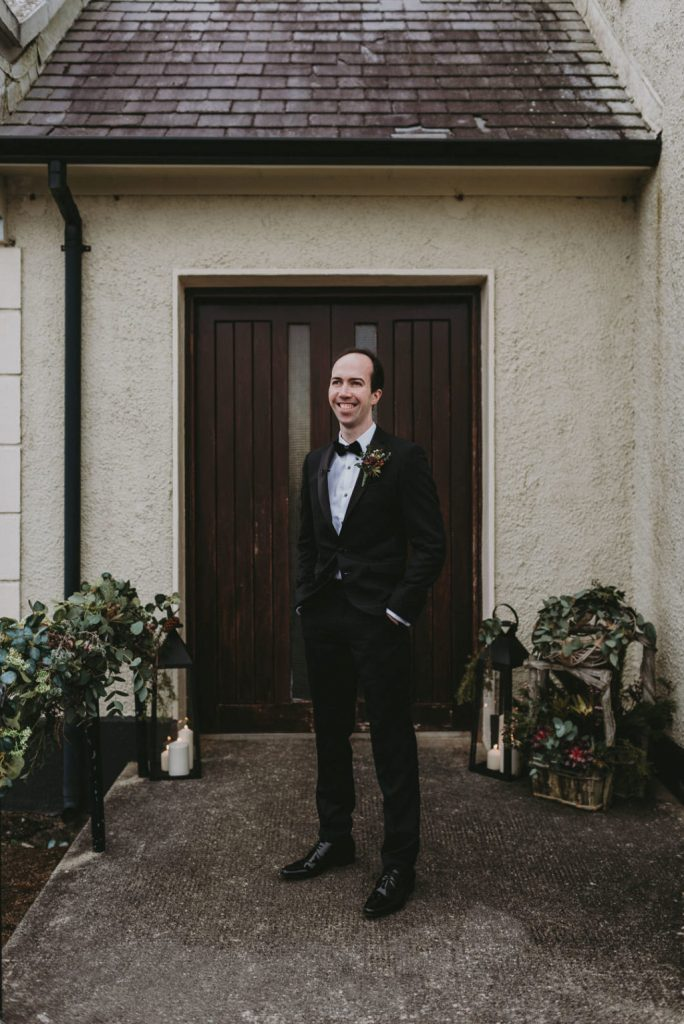 The groom was wearing a black tux with a velvet bow tie and a cool boutonniere