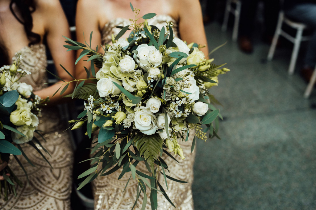 The wedding bouquets were white ones, with greenery, leaves and foliage for texture