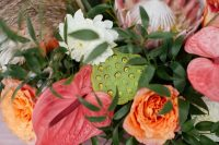 05 The wedding florals were done with pink, orange and white blooms, king proteas and greenery