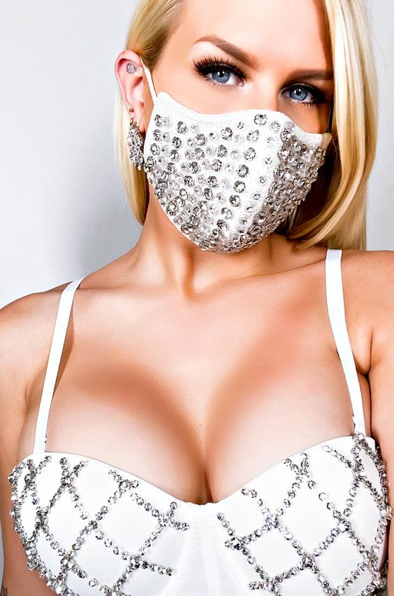a heavily embellished white face mask for accenting a bridal or bridesmaid look and giving it a glam feel to the outfit