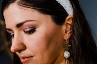 06 The bridal accessories were gorgeous – a white sequin headpiece and a statement star and mother of pearl earring
