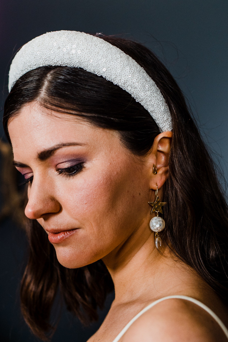 The bridal accessories were gorgeous   a white sequin headpiece and a statement star and mother of pearl earring