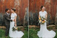 06 The bride was wearing a cute and romantic updo with fresh blooms and som waves down