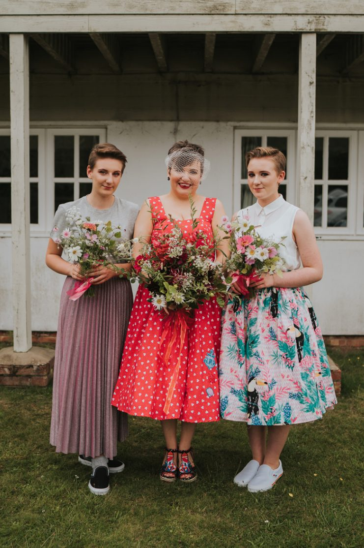 The bridesmaids were wearing mismatching looks with tees and midi skirts