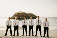 06 The groom and groomsmen were wearing black pants, white shirts and dark floral ties