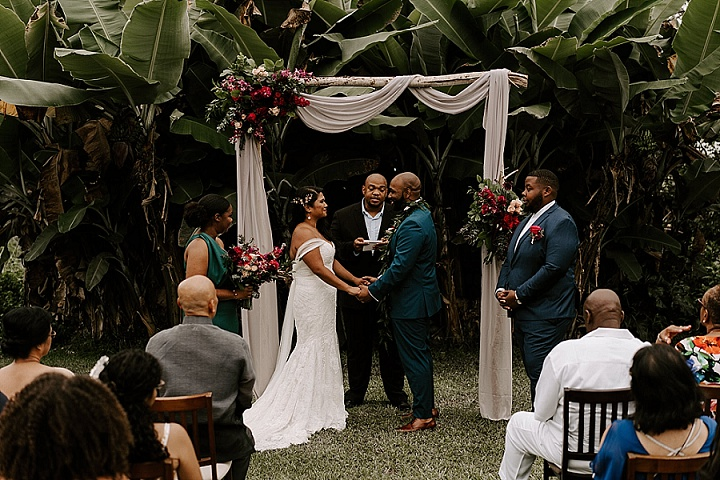 The groomsman was wearing a navy suit, the bridesmaid was rocking an emerald dress
