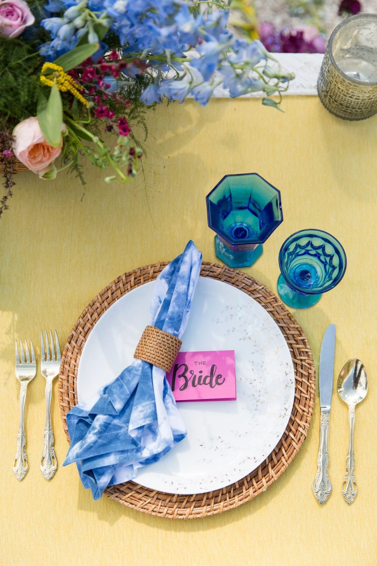 The place settings were done with woven placemats, tie-dye napkins and refined silver