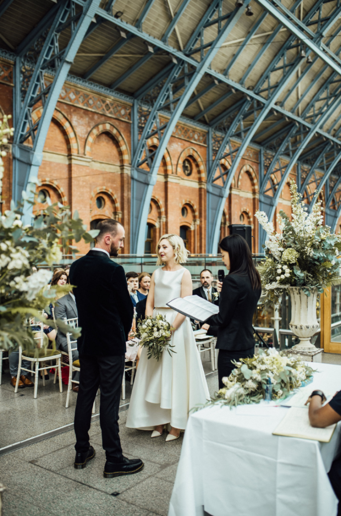 The wedding ceremony took place right at the station, which was decorated with blooms
