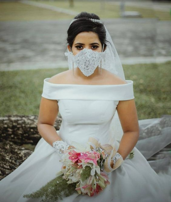 a lace embellished face mask is a lovely and romantic wedding accessory to highlight your bridal look