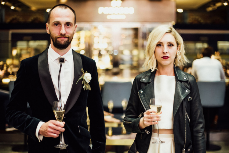 The bride was rocking a leather jacket and cool statement earrings for a bold look