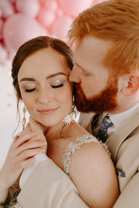 The bride was rocking celestial earrings