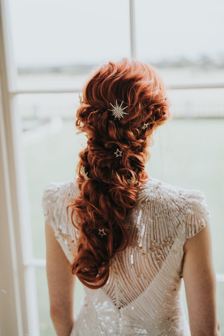 The long twisted ponytail was highlighted with star hairpins