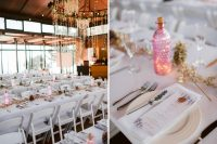 07 The reception space was done elegant, with lavender, gilded pinecones and herbs, pink bottles with candles