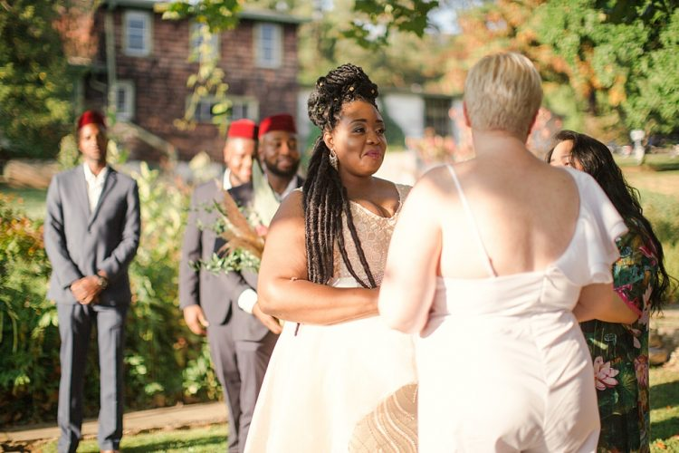 The wedding hair of Chidera was a half updo with beads and it looked very African-style