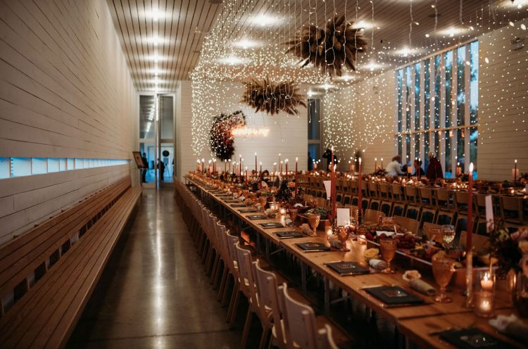 The wedding reception was adorable, with lots of lights, pampas grass, thin and tall candles and dark touches