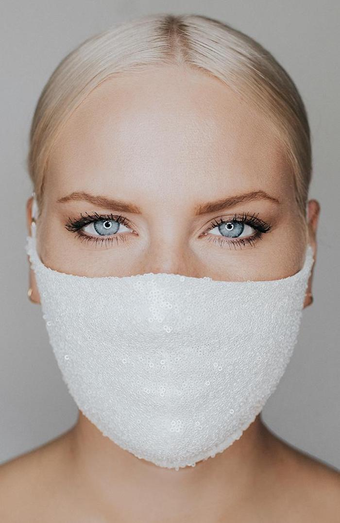 a minimalist yet shiny white sequin face mask for a bride or bridesmaids is a modern solution