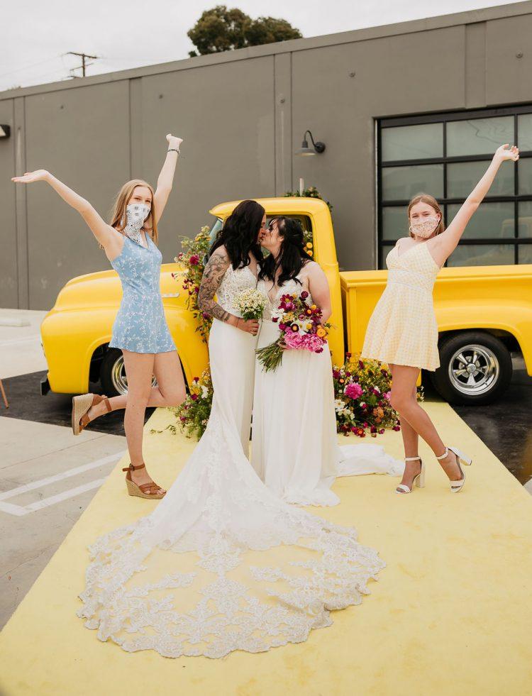 The bridesmaids were wearing mismatching pastel mini dresses