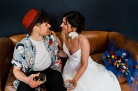 08 The groom was wearing black pants, a colorful printed shirt, a white tee and a red hat