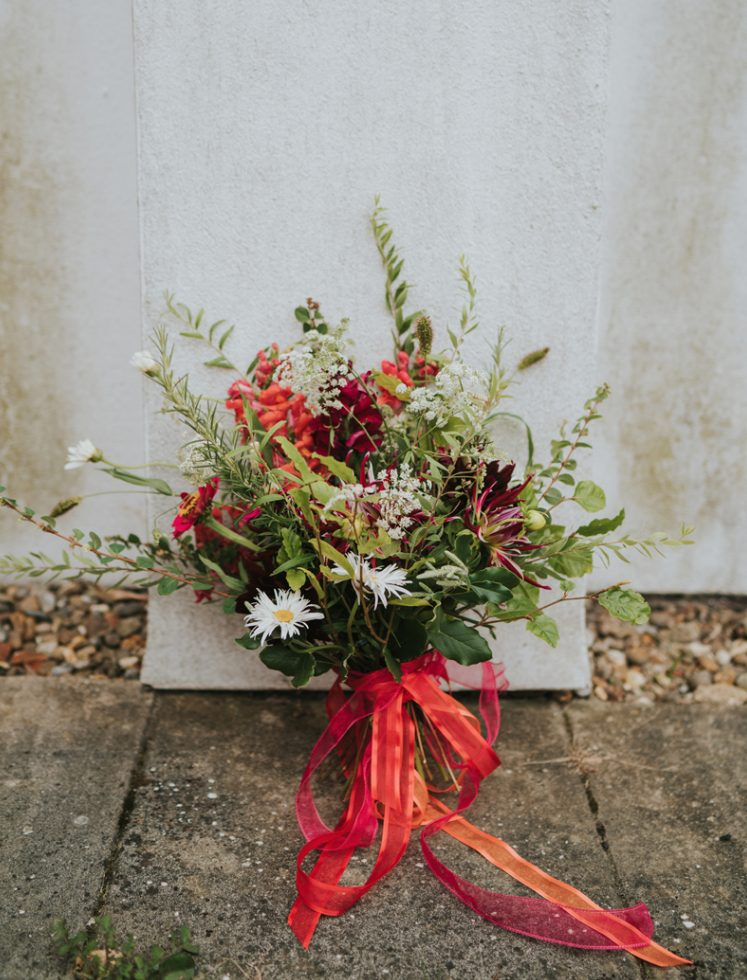 The wedding bouquet was a textural one, with lots of greenery in red, burgundy and white